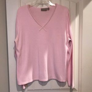 Classy pink sweater with pearl accents around neck